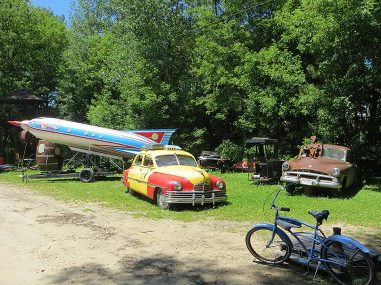 Rocket ship and old Cars
